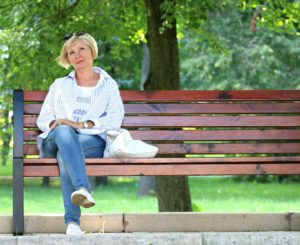 Lady on bench with crossed legs