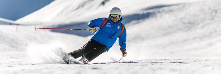 Man in blue coat skiing